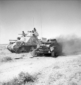 British M3 Tank next to burned Panzer tank in No. Africa, June 1942. Courtesy Imperial War Museum