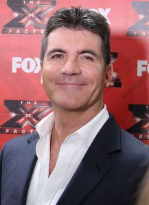 Imagine an amusement park filled with people wearing Simon Cowell masks...