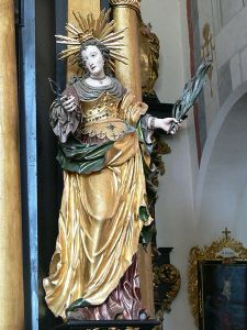 St. Apollonia, who as a martyr had all her teeth pulled. Patroness of dentistry. Her statue, in Fludd, is buried.