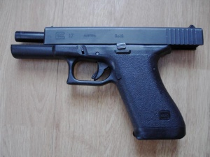 First-generation Glock 17, important to the story. The firearm has been updated often since introduction in early 80s but Sue Grafton is careful about period details so I'm showing you a period firearm.